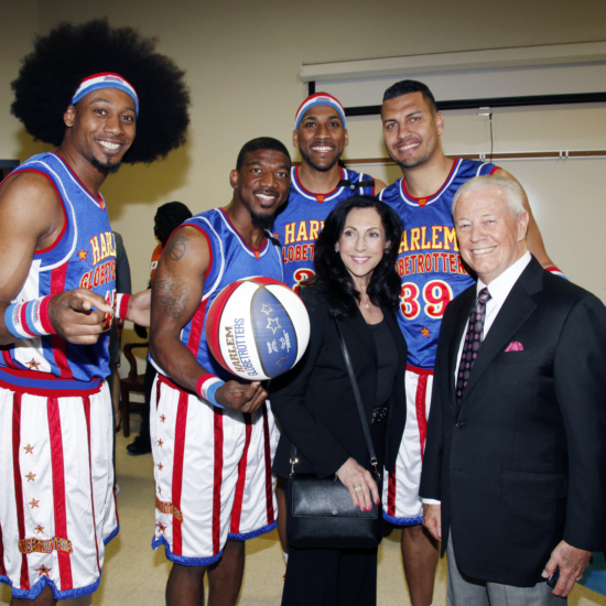 Cynthia & Dr. Savelle w Globetrotters